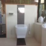 Badideen mit Mosaikfliesen hinter dem WC